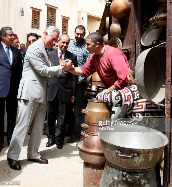 Prince Charles Prince of Wales is greeted by a local man during a tour of the old city on April 6 2011 in Fez Morocco Prince Charles Prince of Wales...