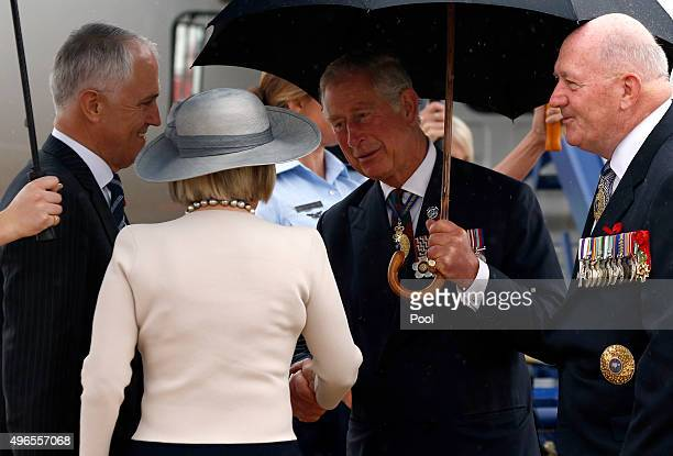 Prince Charles Prince of Wales is greeted by Australian Prime Minister Malcolm Turnbull his wife Lucy Turnbull and the Australian Governor General...