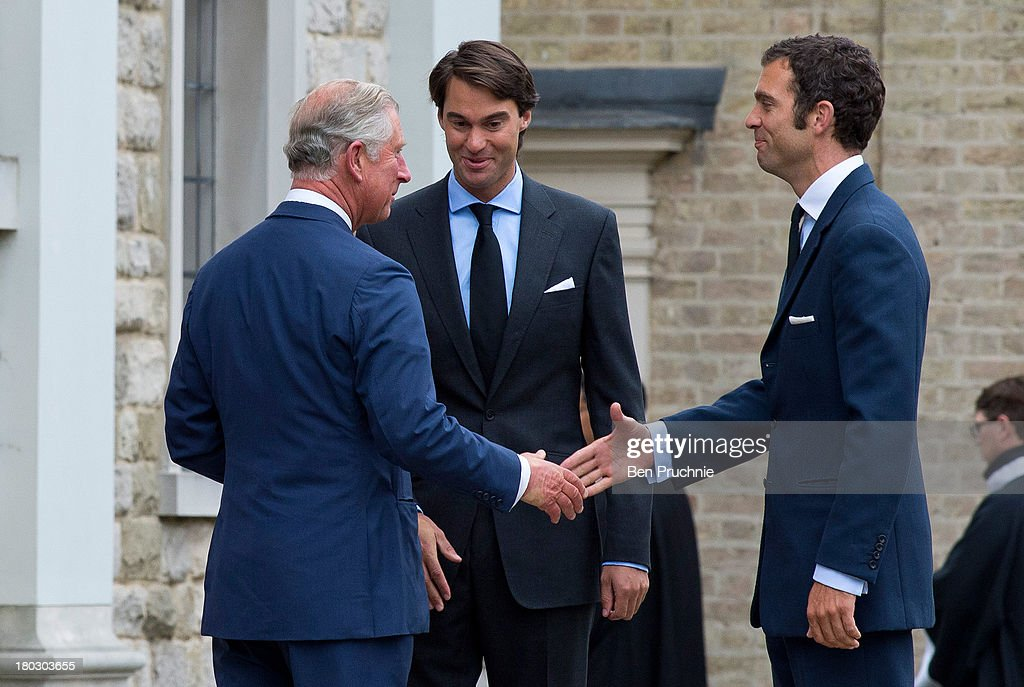 <a gi-track='captionPersonalityLinkClicked' href=/galleries/search?phrase=Prince+Charles&family=editorial&specificpeople=160180 ng-click='$event.stopPropagation()'>Prince Charles</a>, Prince of Wales (L) is greeted by Hugh van Cutsem Jr(R) and William van Cutsem while attending a requiem mass for Hugh van Cutsem who passed away on September 2nd 2013 at Brentwood Cathedral on September 11, 2013 in Brentwood, England.