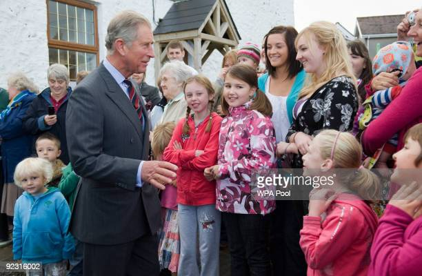 Prince Charles Prince of Wales is greeted by local people during his visit to Abaca Organic an organic mattress factory on October 23 2009 in...