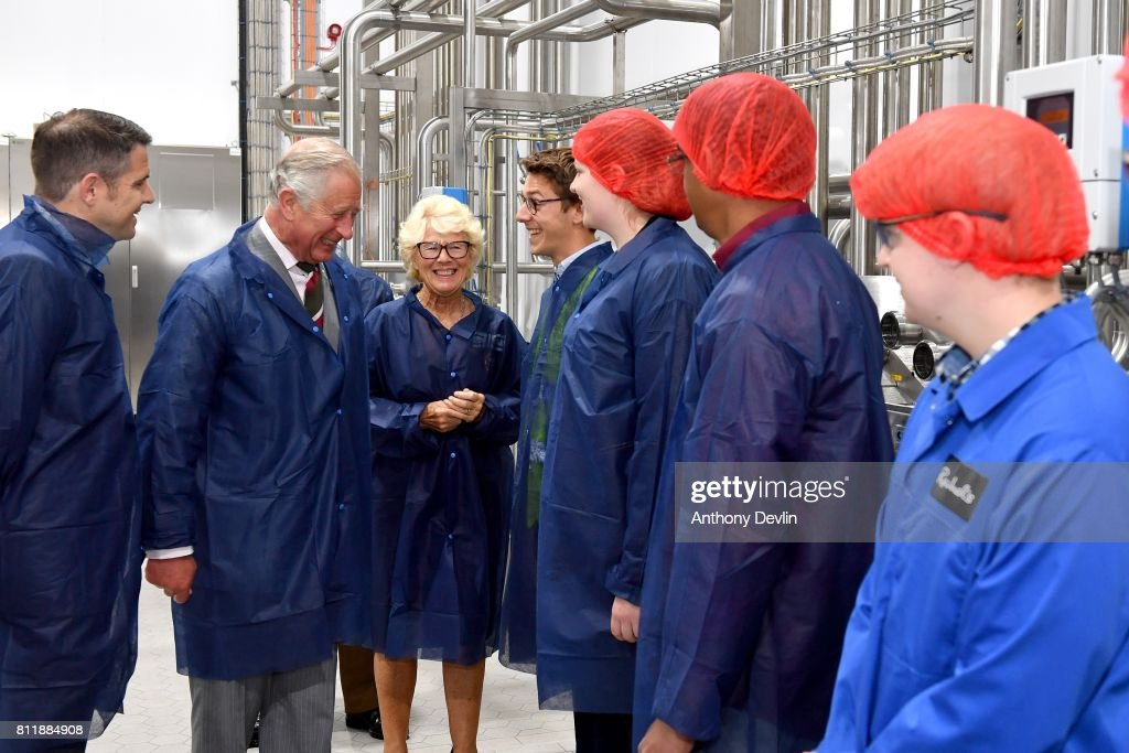 Prince Charles, Prince of Wales is joined by Rachel Cooper (C) founder of Rachel's Organic, and Richard Cooper, Plant Manager (L) as he speaks with employees on a tour of the firms new extension during The Prince of Wales' annual Summer visit to Wales at Rachel's Organic on July 10, 2017 in Aberystwyth, Wales. Rachel's was Britain's first organic dairy and was a pioneer of branded organic produce. The company supplies a range of organic products, all made simply, using the highest quality ingredients, with no artificial colours, flavourings or preservatives.