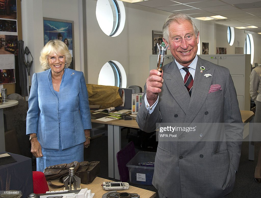 <a gi-track='captionPersonalityLinkClicked' href=/galleries/search?phrase=Prince+Charles+-+Prince+of+Wales&family=editorial&specificpeople=160180 ng-click='$event.stopPropagation()'>Prince Charles</a>, Prince of Wales is pictured with the sonic screwdriver as <a gi-track='captionPersonalityLinkClicked' href=/galleries/search?phrase=Camilla+-+Duchess+of+Cornwall&family=editorial&specificpeople=158157 ng-click='$event.stopPropagation()'>Camilla</a>, Duchess of Cornwall looks on during their visit to the set of the BBC One drama series 'Doctor Who' at BBC Roath Lock Studios on July 3, 2013 in Cardiff, Wales.