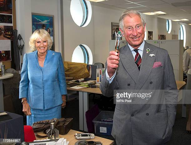 Prince Charles Prince of Wales is pictured with the sonic screwdriver as Camilla Duchess of Cornwall looks on during their visit to the set of the...