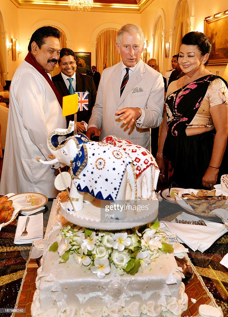 Prince Charles, Prince of Wales (centre) is presented with a birthday cake topped with three Elephants, by the President of Sri Lanka <a gi-track='captionPersonalityLinkClicked' href=/galleries/search?phrase=Mahinda+Rajapaksa&family=editorial&specificpeople=588377 ng-click='$event.stopPropagation()'>Mahinda Rajapaksa</a> (left) and his wife Shiranthi (right) at the Presidents Palace on November 14, 2013 in Colombo, Sri Lanka. The Royal couple are visiting Sri Lanka in order to attend the 2013 Commonwealth Heads of Government Meeting.