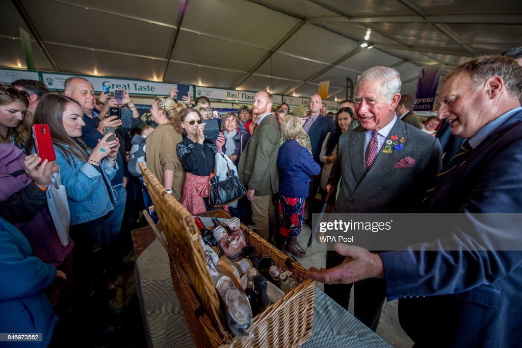 Prince Charles, Prince of Wales is presented with a food Hamper from all of the stall holders at the food hall as he visits The Westmorland County Show on September 14, 2017 in Milnthorpe, England. During his tour of the Westmorland Show Prince Charles presented prizes and toured the many farm animal displays and exhibition marquees.