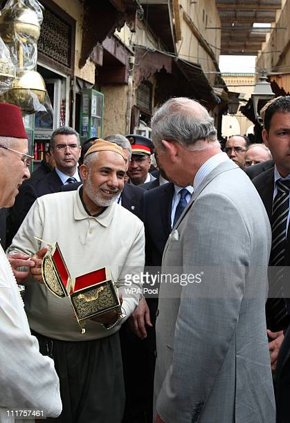 Prince Charles Prince of Wales is presented with a gift from a local trader during a tour of the old city on April 6 2011 in Fez Morocco Prince...