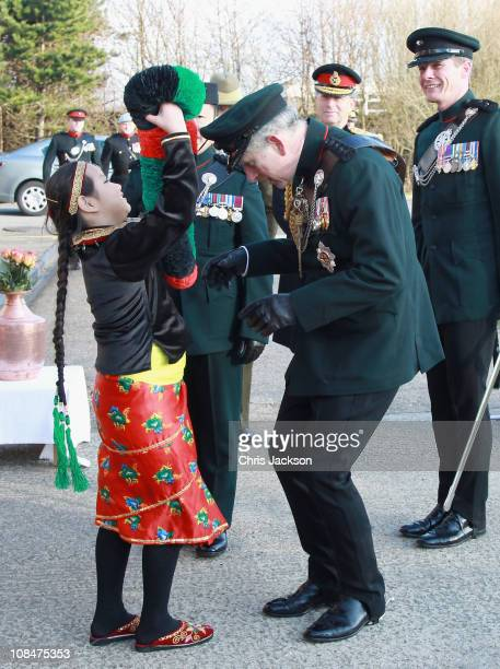 Prince Charles Prince of Wales is presented with a traditional garland after presenting Afghanistan Service Medals to Gurkas at Sir John Moore...