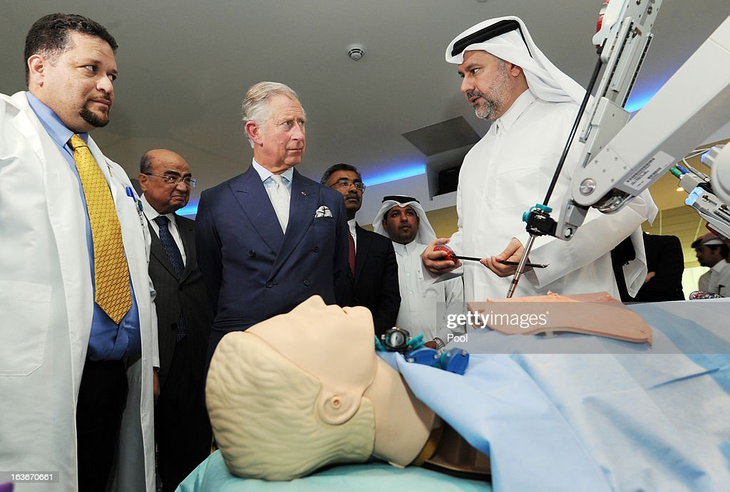 Prince Charles, Prince of Wales is shown a dummy for use in practicing micro robotic Heart surgery, by Professor Abdullah Al Ansari (right) during a tour of the Science and Technology park on the fourth day of a tour of the Middle East on March 14, 2013 in Doha, Qatar. The Royal couple are on the second leg of a tour of the Middle East taking in Qatar, Saudia Arabia and Oman.