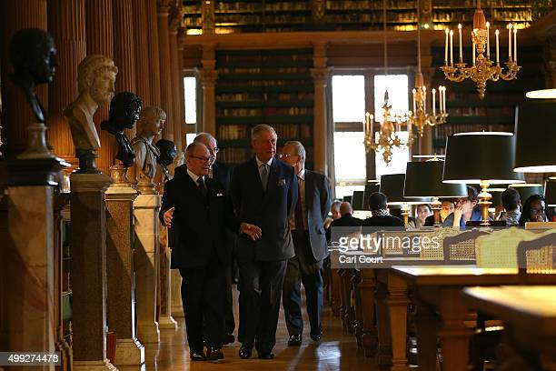 Prince Charles Prince of Wales is shown around the library with French historian Gabriel de Broglie during a visit to the Institut De France where he...