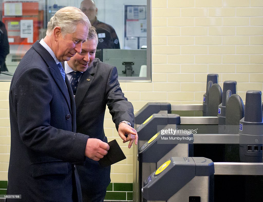 Prince Charles, Prince of Wales is shown how to use his Oyster Card to pass through the ticket gate at Farringdon Underground Station as he prepares to travel on a Metropolitan underground train to King's Cross on January 30, 2013 in London, England. The Prince of Wales and The Duchess of Cornwall are marking the 150th anniversary of London Underground to emphasise the importance of engineering and infrastructure development in the UK.