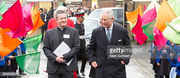 Prince Charles Prince of Wales is welcomed by Dhol drummers on a visit to St John's Church on February 10 2016 in Southall England