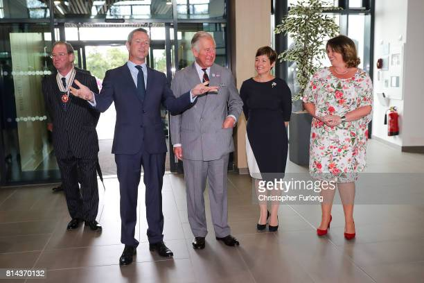 Prince Charles Prince of Wales is welcomed to the headquarters of Moneypenny Ltd by cofounders Ed Reeves Rachel Clacher and company director Joanna...