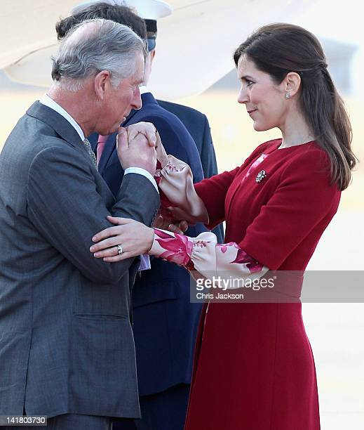 Prince Charles Prince of Wales kisses Princess Mary of Denmark's hand as he arrives at Copenhagen Kastrup Airport on March 24 2012 in Copenhagen...