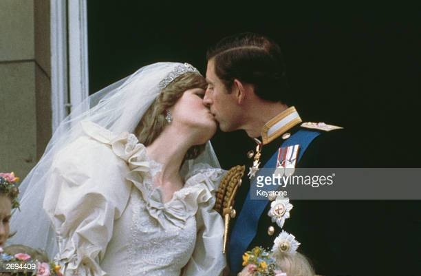 Prince Charles the Prince of Wales kissing his wife Princess Diana on the balcony of Buckingham Palace in London after their marriage