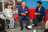 Prince Charles Prince of Wales laughs as he is given a cup of tea with two spoons in it by mistake during a visit to his his Prince's Trust centre...
