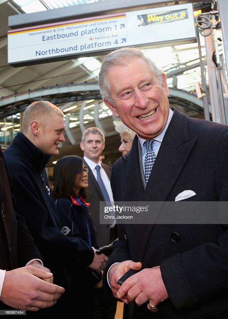 Prince Charles, Prince of Wales laughs as he prepares to travel on a Metropolitan underground train at Farringdon Station as he and Camilla, Duchess of Cornwall (not pictured) mark 150 years of London Underground on January 30, 2013 in London, England.