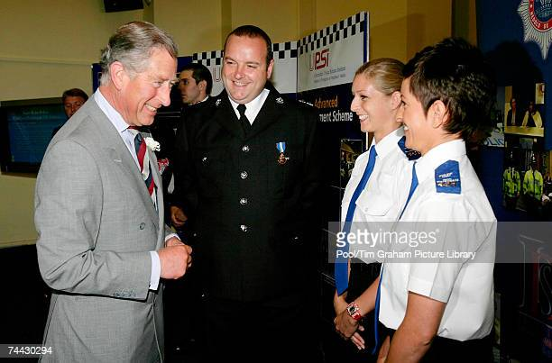 Prince Charles Prince of Wales laughs with Inspector Peter Rees and community support officers Katie Clatworthy and Sharyn Gibbs as he opens the...