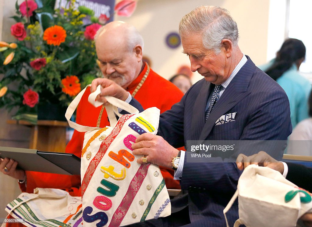 Prince Charles, Prince of Wales looks at an embroidered bag, a gift, during a visit to St John's Church on February 10, 2016 in Southall, England. The Prince met members of the congregation and heard about the church's inter-faith work and role in the local community.