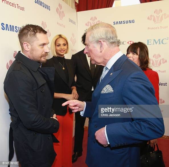 Prince Charles Prince of Wales meets actor Tom Hardy as Alesha Dixon looks on as they attend The Prince's Trust Celebrate Success Awards at London...