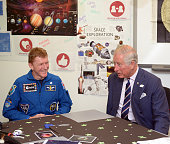 Prince Charles Prince of Wales meets British astronaut Tim Peake during a visit to his Prince's Trust centre where the charity's beneficiaries staff...