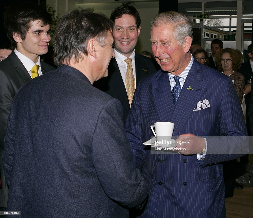 Prince Charles, Prince of Wales meets chef Raymond Blanc (L) as he, accompanied by Jamie Oliver, visits Carshalton Boys Sports College to see how the school has transformed its approach to healthy eating on November 26, 2012 in Carshalton, England.