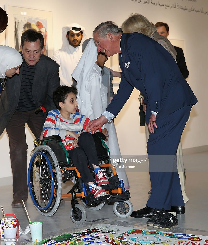 <a gi-track='captionPersonalityLinkClicked' href=/galleries/search?phrase=Prince+Charles&family=editorial&specificpeople=160180 ng-click='$event.stopPropagation()'>Prince Charles</a>, Prince of Wales meets children at an art project in the Katara Cultural Village on the fourth day of a tour of the Middle East on March 14, 2013 in Doha, Qatar. The Royal couple are on the second leg of a tour of the Middle East taking in Qatar, Saudia Arabia and Oman.