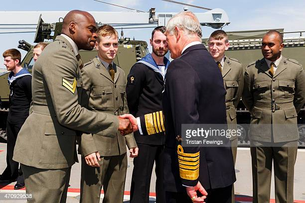 Prince Charles Prince of Wales meets crew members on HMS Bulwark at a reception for decendants of the Gallipoli campaign on April 24 2015 in...