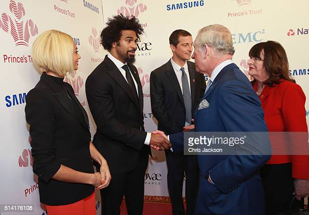 Prince Charles Prince of Wales meets David Haye as Alesha Dixon and Bear Grylls look on as they attend The Prince's Trust Celebrate Success Awards at...