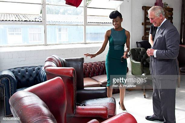 Prince Charles Prince of Wales meets Demi an entrepreneur supported by the Prince's Trust on September 9 2014 in London England