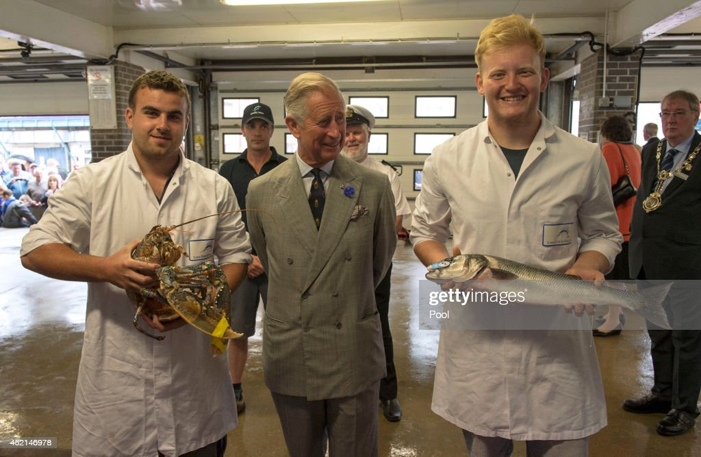 <a gi-track='captionPersonalityLinkClicked' href=/galleries/search?phrase=Prince+Charles&family=editorial&specificpeople=160180 ng-click='$event.stopPropagation()'>Prince Charles</a>, Prince of Wales meets fish market porters Sam Chapman with a large lobster and Sean Coomber with a sea bream helped by the Princes Trust during his visit in Cornwall on July 14, 2014 in Looe, England.