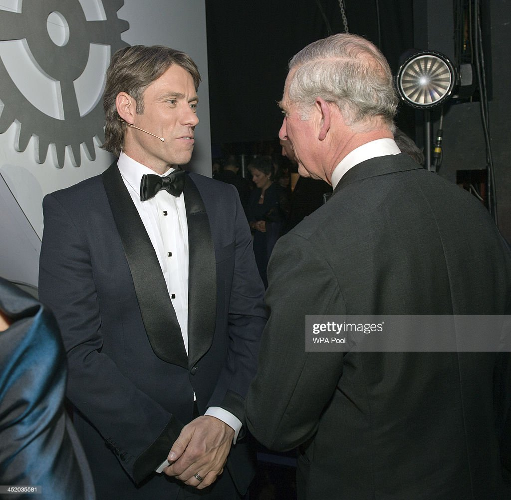 Prince Charles, Prince of Wales meets John Bishop at the Royal Variety Performance at London Palladium on November 25, 2013 in London, England.