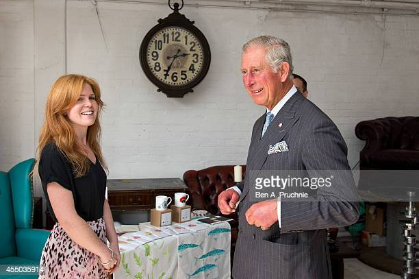 Prince Charles Prince of Wales meets Liz Temperley an entrepreneur supported by the Prince's Trust on September 9 2014 in London England