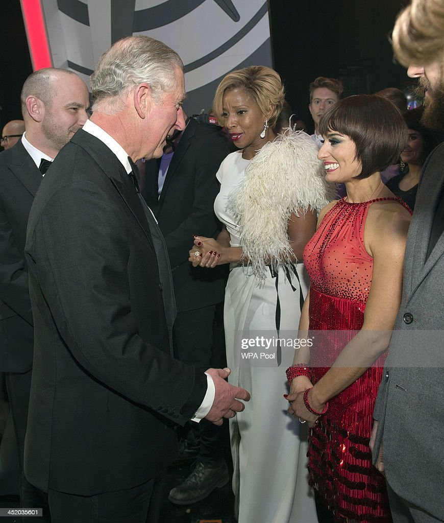 Prince Charles, Prince of Wales meets Mary J. Blige and Flavia Cacace at the Royal Variety Performance at London Palladium on November 25, 2013 in London, England.