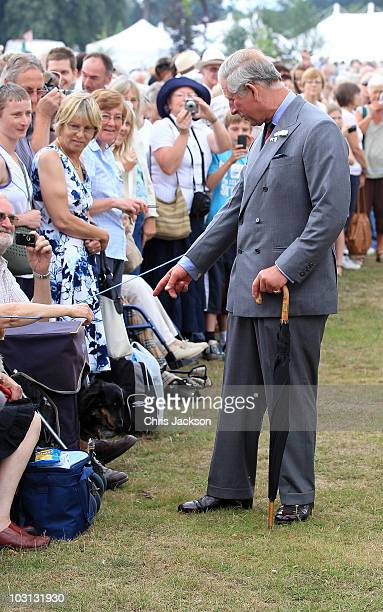 28 28 28 Prince Charles Prince of Wales meets members of the public as he attends Sandringham Flower Show in a carriage at Sandringham on July 28...