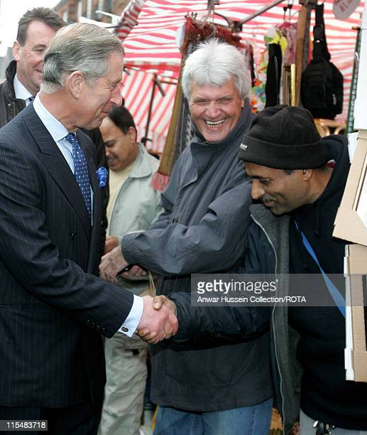 Prince Charles Prince of Wales meets members of the public as he tours Walthamstow street market in north east London on March 29 2007