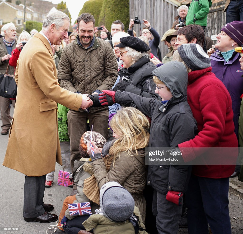 Prince Charles, Prince of Wales meets members of the public during a walkabout whilst visiting the Uley Community Stores and Post Office on February 22, 2013 in Uley, Gloucestershire, England.