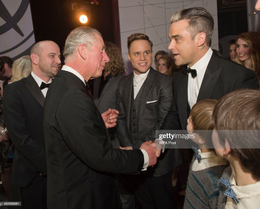 Prince Charles, Prince of Wales meets Olly Murs (L) and Robbie Williams at the Royal Variety Performance at London Palladium on November 25, 2013 in London, England.