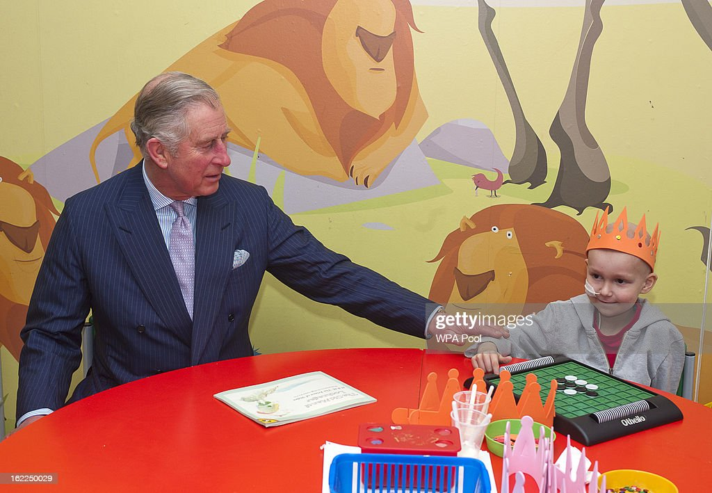Prince Charles, Prince of Wales (L) meets patient Joe Black, 6, in the play area at Great Ormond Street Children's hospital on February 21, 2013 in London, England.