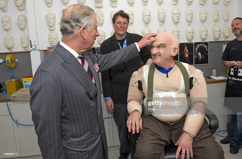 Prince Charles, Prince of Wales meets Peter Hambleton, who plays the Dwarf Gloin in the new 'Hobbit' film, at Weta Workshop on November 14, 2012 in Wellington, New Zealand. The Royal couple are in New Zealand on the last leg of a Diamond Jubilee that takes in Papua New Guinea, Australia and New Zealand.