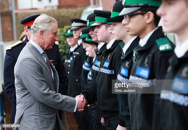 Prince Charles Prince of Wales meets Police Cadets as he visits Burslem Police Station on January 26 2016 in Stoke on Trent England The Prince met...
