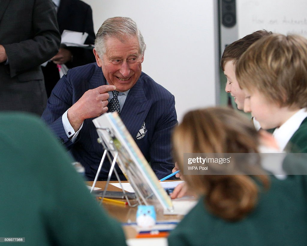 Prince Charles, Prince of Wales meets pupils during a visit to Ashley Primary School on February 10, 2016 in Walton-on-Thames, England.