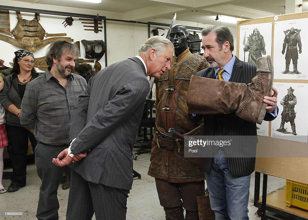 Prince Charles, Prince of Wales meets Sir Peter Jackson and actor William Kircher, who plays Bifur in the new 'Hobbit' film at Weta Workshop on November 14, 2012 in Wellington, New Zealand. The Royal couple are in New Zealand on the last leg of a Diamond Jubilee that takes in Papua New Guinea, Australia and New Zealand.