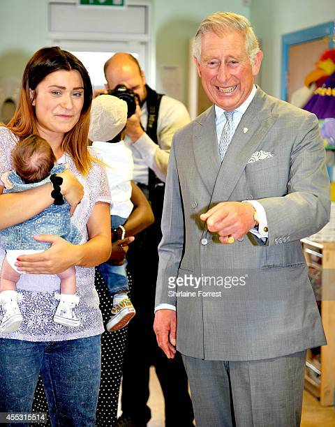 Prince Charles Prince of Wales meets staff and children during an official visit to Lache Primary School on September 12 2014 in Chester England