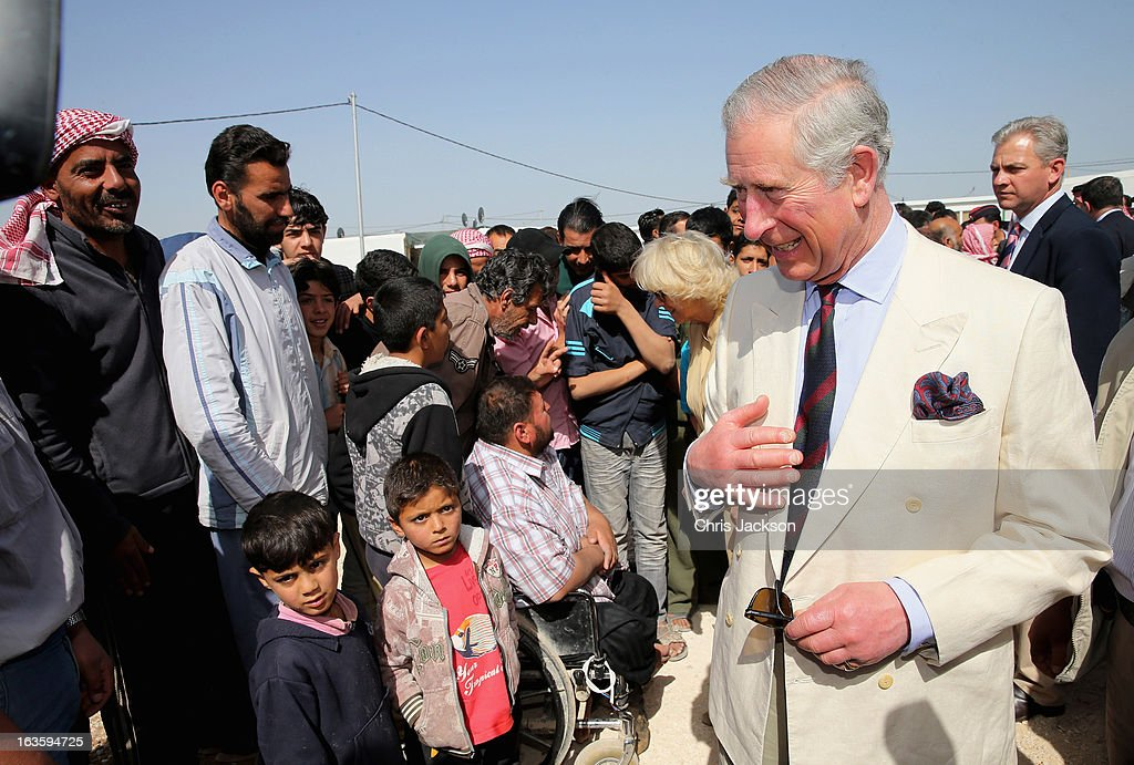 <a gi-track='captionPersonalityLinkClicked' href=/galleries/search?phrase=Prince+Charles+-+Prince+of+Wales&family=editorial&specificpeople=160180 ng-click='$event.stopPropagation()'>Prince Charles</a>, Prince of Wales meets Syrian refugees in the King Abdullah Refugee Camp, 2 kilometers from the Syrian border, on the third day of a visit to the country on March 13, 2013 in Amman, Jordan. The Royal couple are on the first leg of a tour of the Middle East taking in Qatar, Saudia Arabia and Oman.
