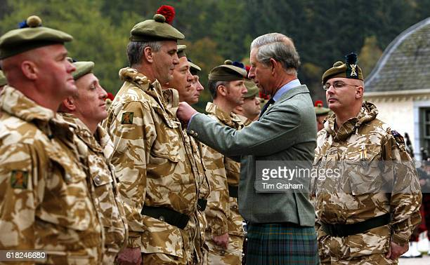 NOVEMBER 2007*** Prince Charles Prince of Wales meets Territorial Army soldiers during a ceremony to present the soldiers from 51st Highland 7th...