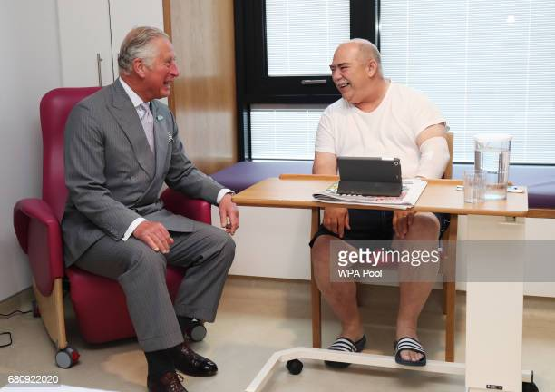Prince Charles Prince of Wales meets Thomas Doherty from Strabane on a tour of the North West Cancer Centre at Altnagelvin Hospital during a visit to...