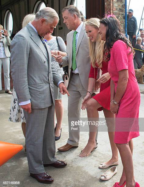 Prince Charles Prince of Wales meets Tori Naismith who proudly presents her camel toe tattoo in memory of her dead brother Ollie Naismith during his...