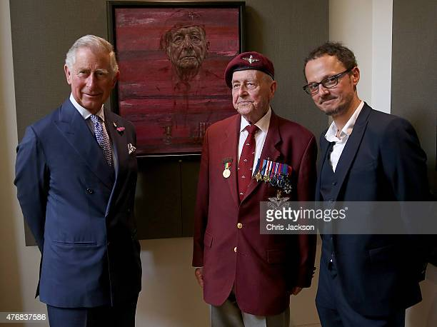 Prince Charles Prince of Wales meets veteran Geoffrey Pattinson whose portrait was painted by Jonathan Yeo on a visit to a DDay Veterans portrait...