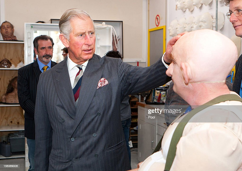 Prince Charles, Prince of Wales meets with Peter Hambleton, who plays the Dwarf Gloin in the new 'Hobbit' film, at Weta Workshop on November 14, 2012 in Wellington, New Zealand. The Royal couple are in New Zealand on the last leg of a Diamond Jubilee that takes in Papua New Guinea, Australia and New Zealand.