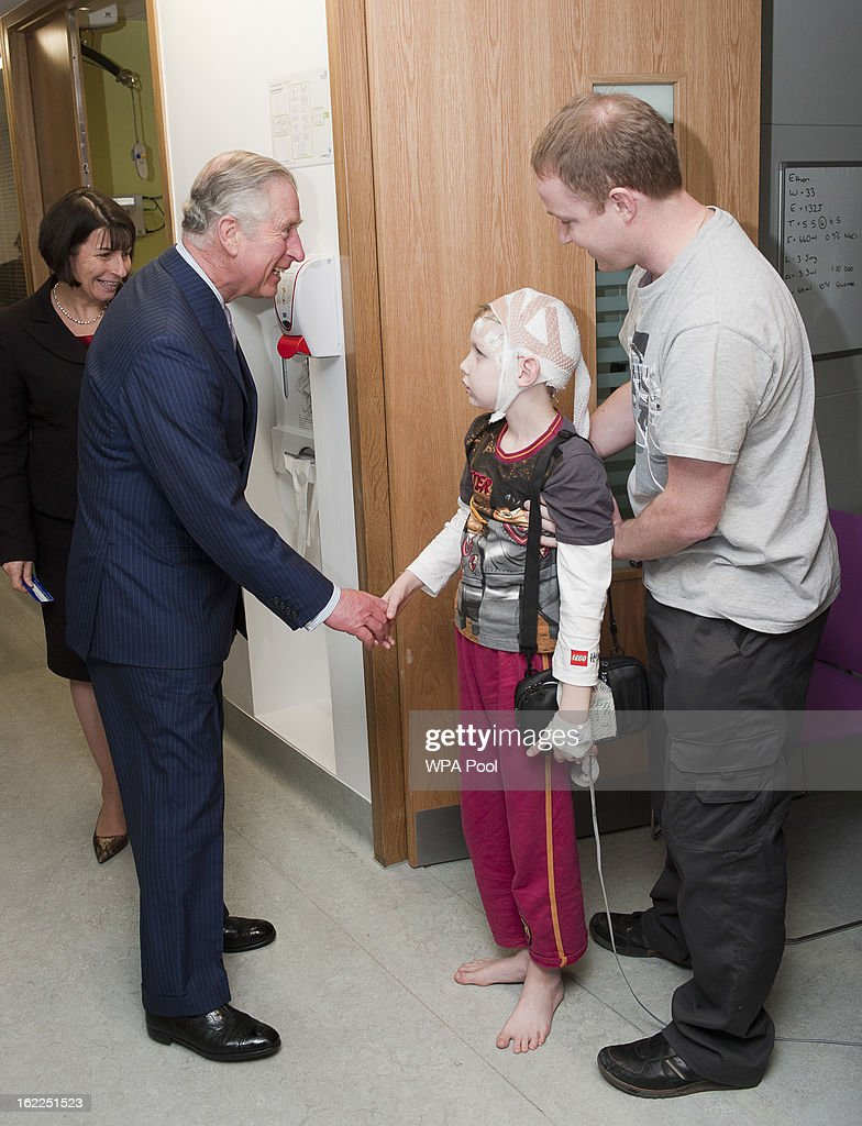 Prince Charles, Prince of Wales meets with staff and patients including Ethan Macey,9, from Wales at Great Ormond Street Children's hospital on February 21, 2013 in London, England.